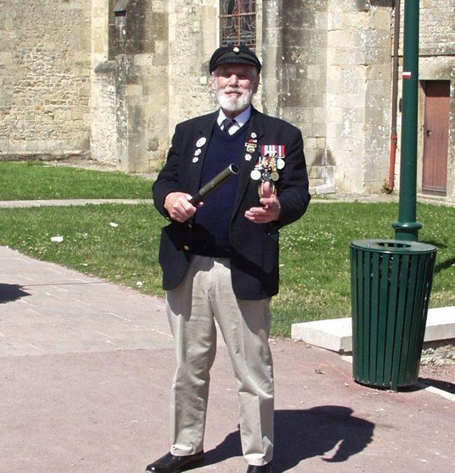 Jim Radford, holding the Baton at St Mere Eglise…